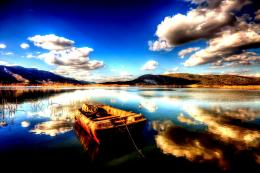 Resting boat reflection peaceful mountains:High Contrast 1736