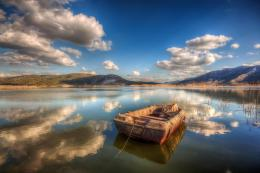 Resting boat reflection peaceful mountains wallpaper 1710