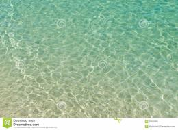 Sea beautiful clear beach ripple water reflecting in the sun 532