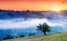 Orange sunset over the foggy valley wallpaper 1280x800 157