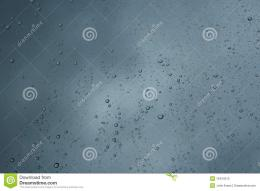 Multiple Raindrops on a window with a stormy background 1265