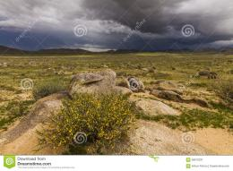 Dramatic landscape with rain clouds over the valley and mountains 1132