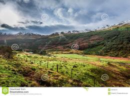 Rain Clouds Over A Mountain Valley Stock ImageImage: 38155321 447