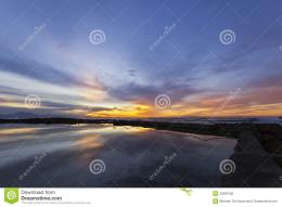 fantastic sunrise with reflections in a tidal pool 729