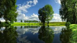 reflection pond shore grass filds trees spring seasons sky clouds 1267