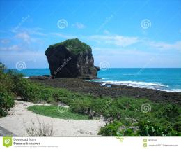huge rock in the shape of a head by the sea 1313