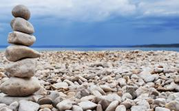 Download Rock stacking on beach wallpaper in Nature wallpapers with 1042