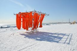 , Sling Swing, in the breeze on a frozen snow covered beach 994