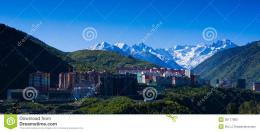 Snow Mountain And City Stock PhotosImage: 30177083 198