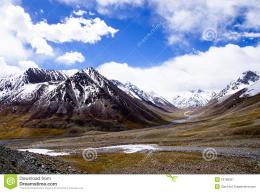 Beautiful landscape of snow mountain under blue sky and white cloud 290