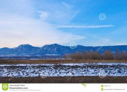 Distant Mountains, Snowbank And Trees Stock PhotosImage: 12931173 563
