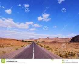 Straight road through the desert in Morocco, Africa 347