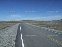 Empty and straight road on desert — Stock Photo © tupungato 1081