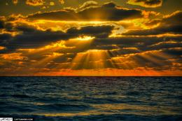 sunrise over atlantic ocean with sun rays going trhough clouds 577