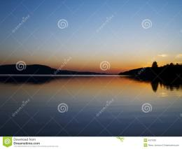 beautiful sunset over calm peaceful lake 191