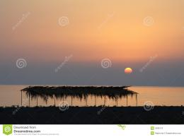 Scenic view of colorful sunset over picturesque beach with silhouetted 1125