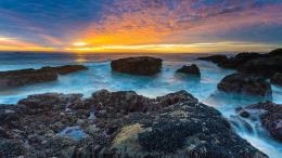 sunset over the rocky beach wallpaper sunset over the rocky beach 429