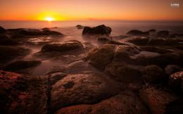 Sunset over the rocky shore 333