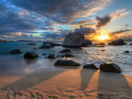 Sunset over rocky beach sea boat clouds 1024x768 1027