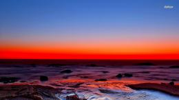 Amazing red sunset over the rocky beach wallpaperBeach wallpapers 1683