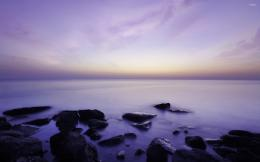 Purple sunset over the mystic rocky beach wallpaper 1152