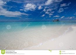 Clear and calm tropical dream beach and pier on the horizon 1261