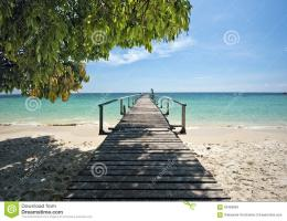 Wooden jetty in tropical beach of Ko Samet island, the shadow from the 905