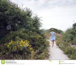 Mature Woman Walking Path To The Beach Stock ImageImage: 37760101 670
