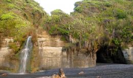 The waterfall on Awakino Beach, just a short walk south from the 1316