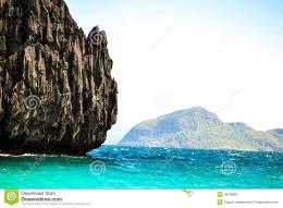 Wonderful view of the turquoise sea and the sea cliffs covered with 905
