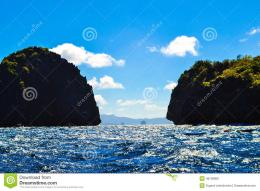 Stock Photo: Wonderful view of the blue sea and the sea cliffs covered 1486