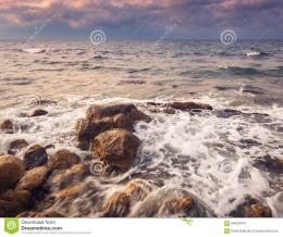Sea waves with rocks on the beach at sunsetBeautiful landscape 1623