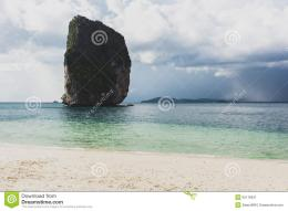 Beautiful rock on beach with dark clouds in Krabi, Thailand 482