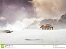 Wooden cottage and snow covered huts in blizard at the peak of snow 146