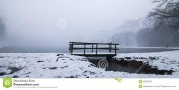 Wooden Bridge In A Winter Lake Stock PhotoImage: 39302365 1594