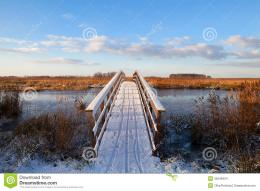 Wooden bridge through river in snow during winter, Groningen 1238