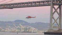 Helicopter flies below San Francisco Oakland Bay Bridge San Francisco 856