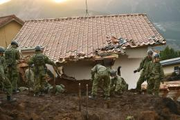 Troops from Japan\'s Ground Self Defense Force search for survivors at 1645