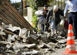 Residents walk through debris from houses destroyed by Thursday\'s 822