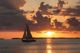 sail boat on calm water at sunset 1231