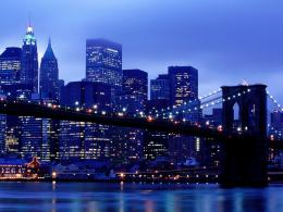 of Brooklyn Bridge and NY skyscrapers in blue color on night lights 386