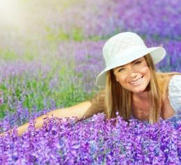 field at sunny day beautiful female sitting on purple flowers me 347