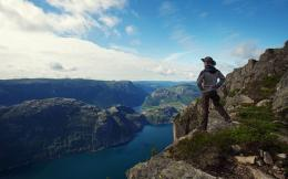 Guy Man traveler hiker fjord panorama sea lonely sky mountain 1504
