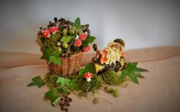 The composition of the basket, moss, acorns, mushrooms, toadstools 382
