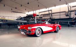 1959 Chevrolet Corvette parked near the airplanes Widescreen Wallpaper 1297