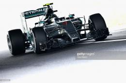 and Mercedes GP drives during final practice for the Formula One Grand 489