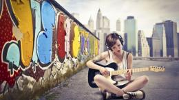 Similar wallpapers for Short hair girl playing guitar nearby graffiti 966