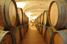 Large oak barrels aging Primitivo at Attanasio winery in Puglia 1685