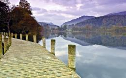 Wooden pier on the lake by the beautiful autumn forest wallpaper 942