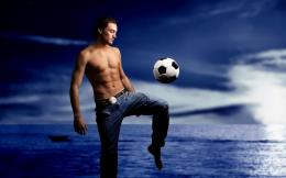 Soccer Football Wallpapers soccerplayer playing football beach 271